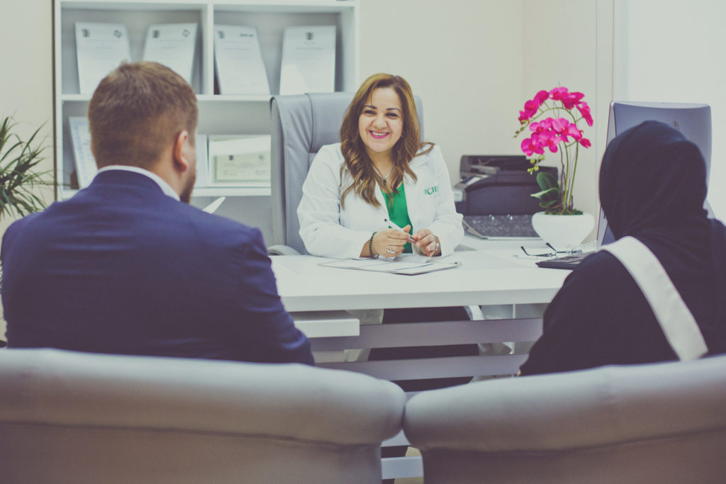 Dr. Bohaira El Geyoushi is pictured consulting with a couple on fertility care and other healthcare options.