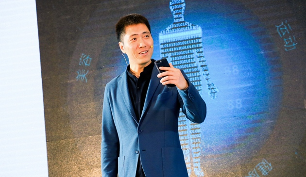 Jun Wang, founder of China-based iCarbonX, showcases an app influenced by artificial intelligence that will use health data to provide customized medical advice.